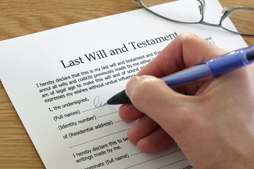 Image of Andrew Gardiner Law client signing a Will