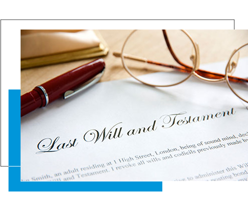 Image of lawyer helping couple write their will